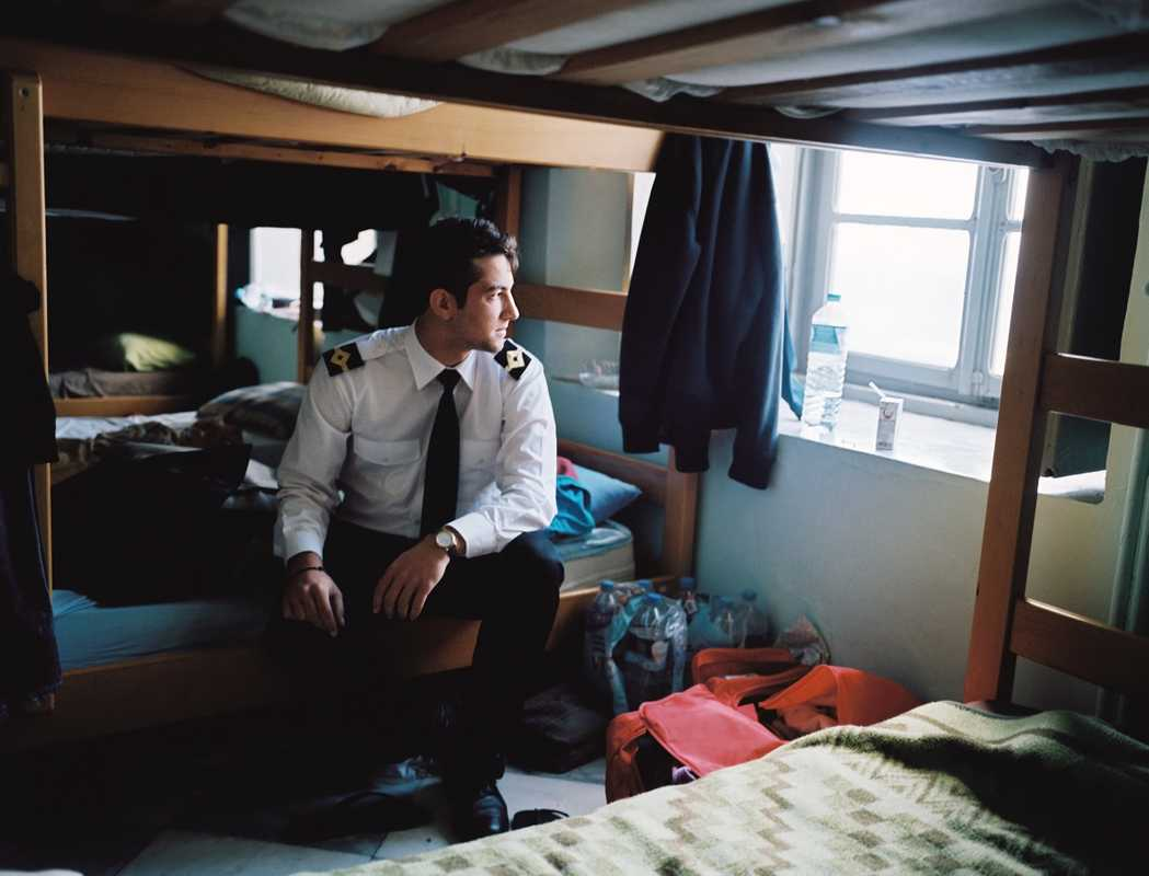 George Pandis, a student at Hydra's merchant marine academy, on his bunk bed