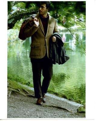 Coat (carried) by The North Face, jacket by Polo Ralph Lauren, jumper by Prada, shirt by Visvim, trousers by Kolor, shoes by Nepenthes, scarf (in bag) by Bottega Veneta, bag by Hermès