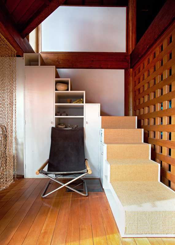 "Stairway: The stairs to the third floor are covered in tatami. Folding ""NY Chair"" by Takeshi Nii, designed in 1958. ""For some reason, I'm not a big fan of new things,"" Ito says."