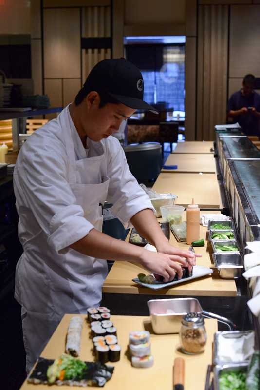 Chef preparing a dish at the sushi bar