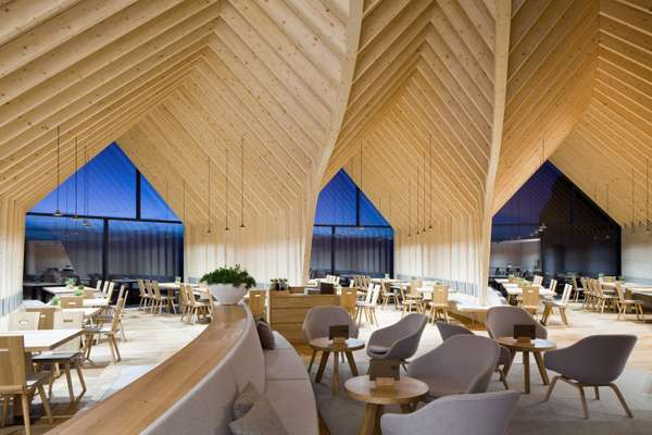 The interior is a complex curvilinear  wood structure