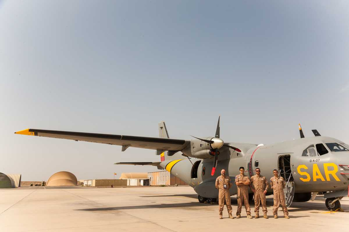 panish airforce personnel from the EU mission show off their  Vigma patrol plane on the Djibouti base airfield