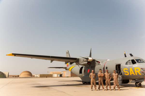 Spanish airforce personnel from the EU mission show off their  Vigma patrol plane on the Djibouti base airfield