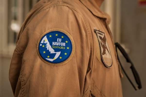 U mission badge reflects its full title and the source of regional instability: Countering Piracy off the Coast of Somalia and Djibouti