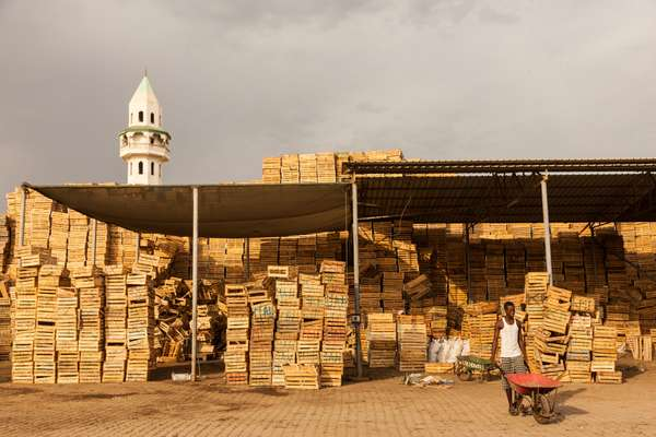 Empty transport crates piled up in Riyad Market indicate how vital imported produce is to life in Djibouti
