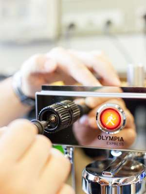 Handcrafting an Olympia Express machine