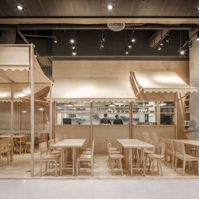 Monochrome interior of Eat that look like it's made entirely from balsa wood