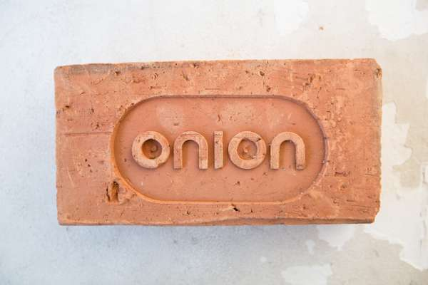 Custom-made brick with the Onion logo