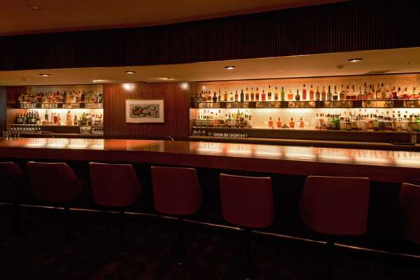 The Orchid Bar in the main wing, a favourite retreat offering beautifully made cocktails and a good steak sandwich