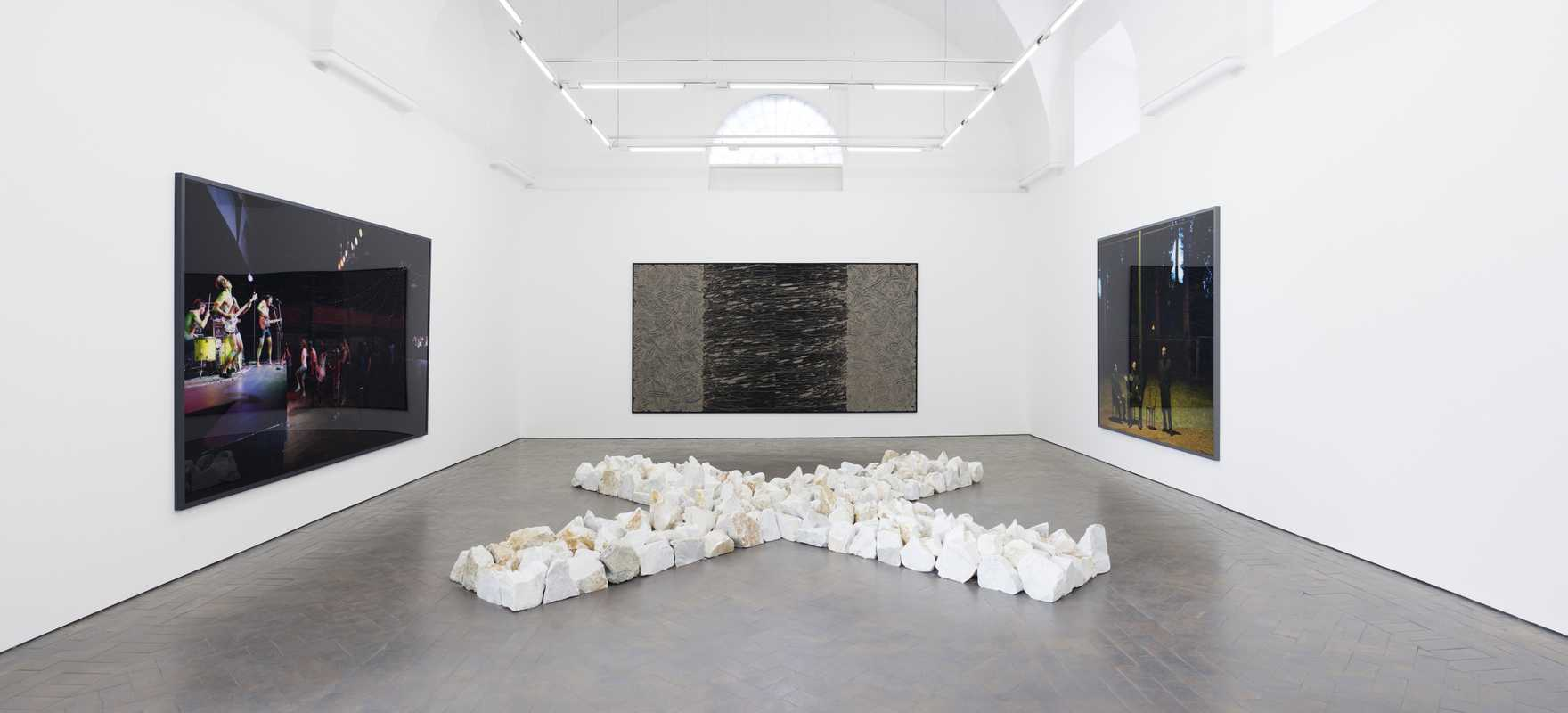 Richard Long stone work and canvas flanked by Jeff Wall photogaphs