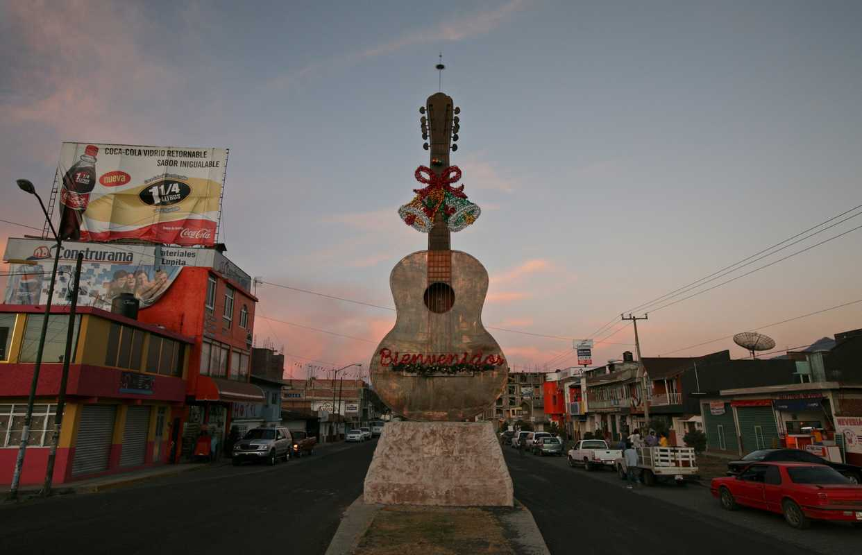 A giant copper statue of a guitar welcomes visitors to Paracho