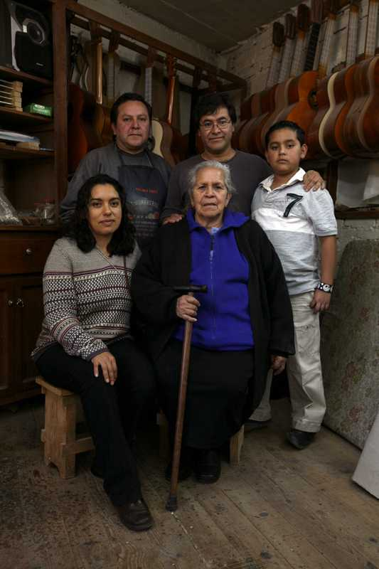 García (centre, back row) with the family – his brother (to his right), son, wife Veronica (left, front row) and mother