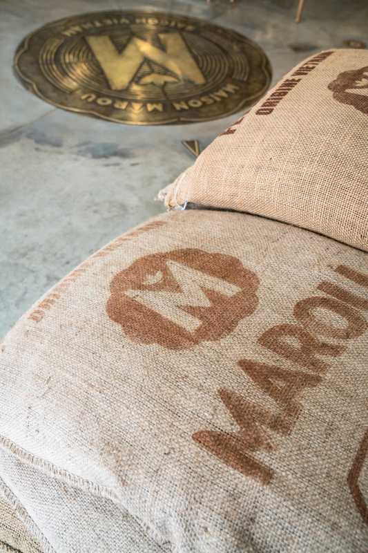 Raw cacao beans in bags that bear the Marou logo