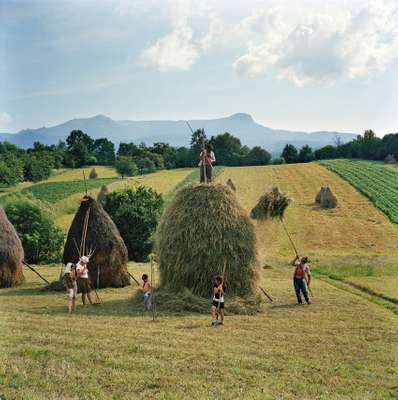 Rena Effendi: The Borca family finishes one of the 40 haystacks it makes every summer in Maramures, Romania
