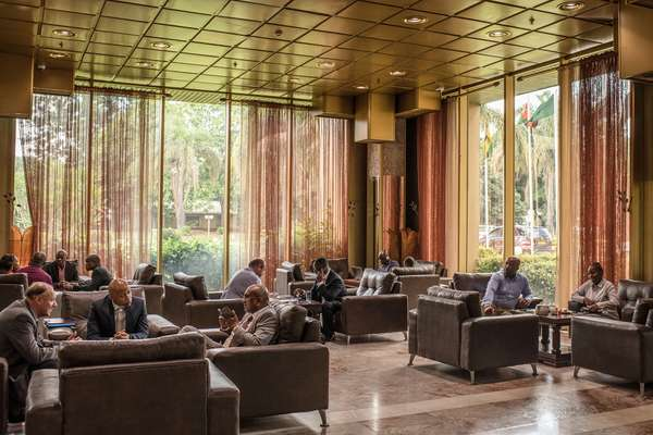 Business meetings in the lobby of the Rainbow Towers Hotel in Harare