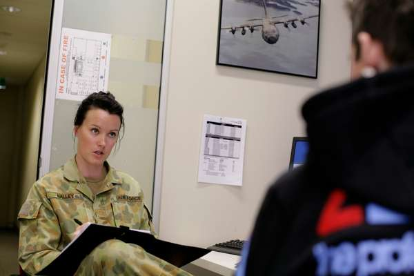 Corporal Renae Halley interviewing a prospective recruit for the Australian Defence Force