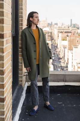 Boiled-wool coat, cashmere crewneck and suede loafers