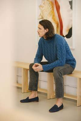 Cashmere cable-knit turtleneck and suede loafers