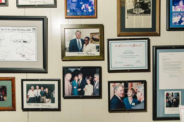 Photos of Bill Clinton line the walls of Doe's Eat Place
