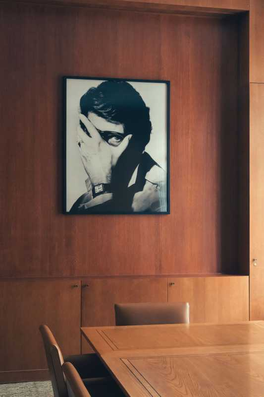 Oak-lined boardroom in Paris with a portrait of Saint Laurent