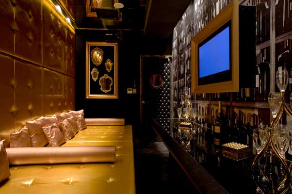 The six-person Room A is dominated by a huge gold vinyl daybed and padded walls with a private champagne bar and karaoke plasma screen along one side