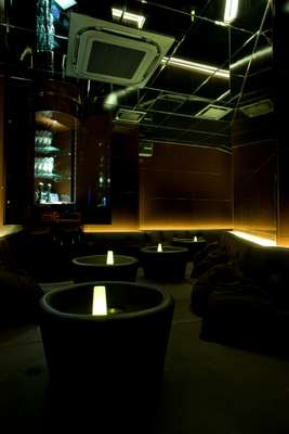 Room D has a black leather platform with circular tables, and mirrored walls and ceilings