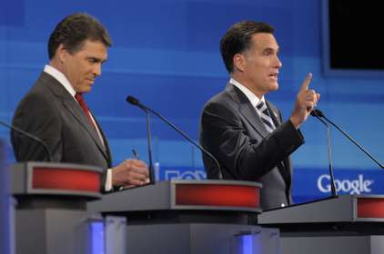 Mitt Romney (right) during a 2011 debate