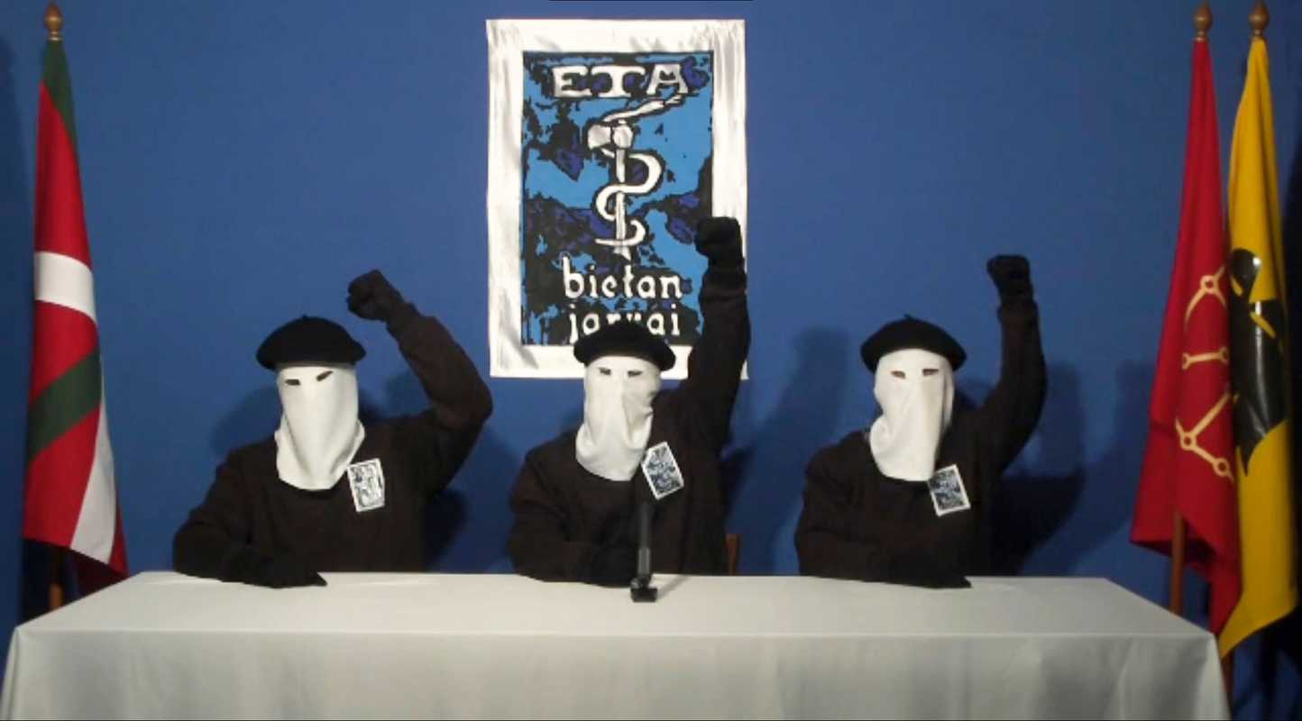 Though the push for Catalan independence was largely non-violent, not all movements in the region were peaceful. Here three members of Basque separatist group eta are calling for a definitive end to 50 years of armed struggle, which had cost the lives of at least 850 people.