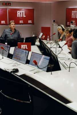 Yves Calvi, RTL morning host, and his team