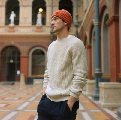 Jumper by APC, T-shirt by Calida, trousers by Circolo 1901, beanie by Begg & Co