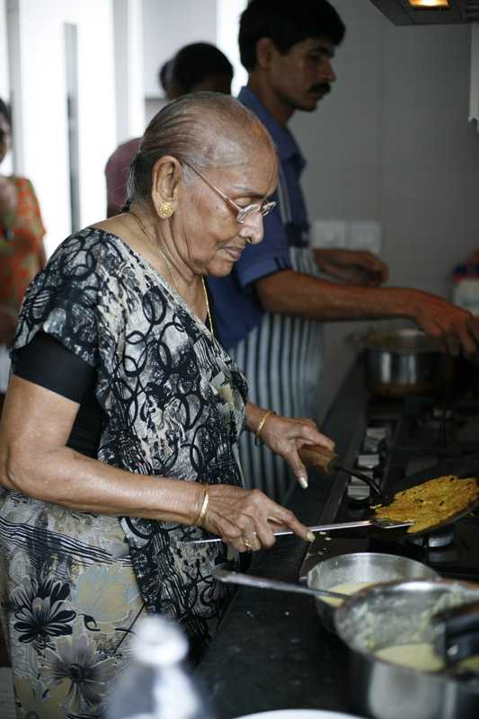 Gupta's mother cooks in his kitchen