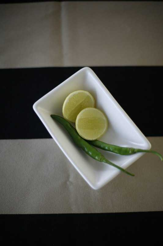 Garnish of lemon and chilli