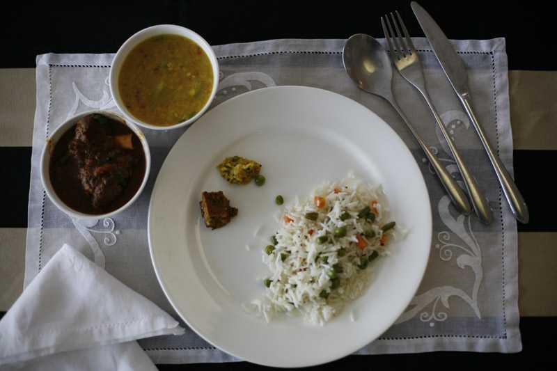 Plate of rice with a daal and lamb curry