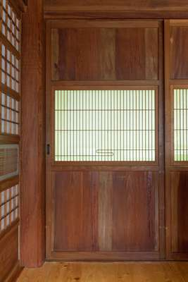 Sliding doors are one of many traditional features in Smiles' lakeside retreat