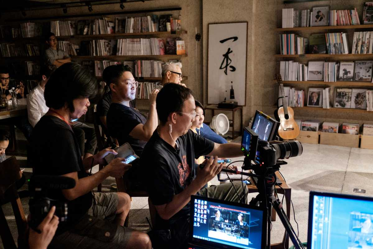 Producer Johnason Lo and crew getting the set ready for action