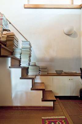 Staircase piled high with books and journals