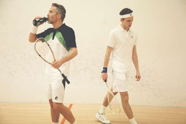 Ben wears black, green and white t-shirt by Dunlop, shorts by Lotto, wristband and shoes by Nike, racquet by Wilson, drinks bottle by Asics. Chay wears white headband and blue wristband by Asics, polo shirt by Nike, shorts by Fred Perry, shoes and racquet by Wilson