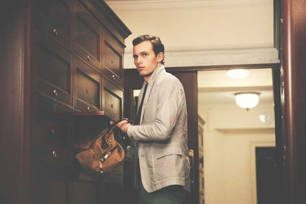Chay wears jacket by Oliver Spencer, shirt and trousers by Hackett, tie by TS(S), bag by Woolrich John Rich & Bros