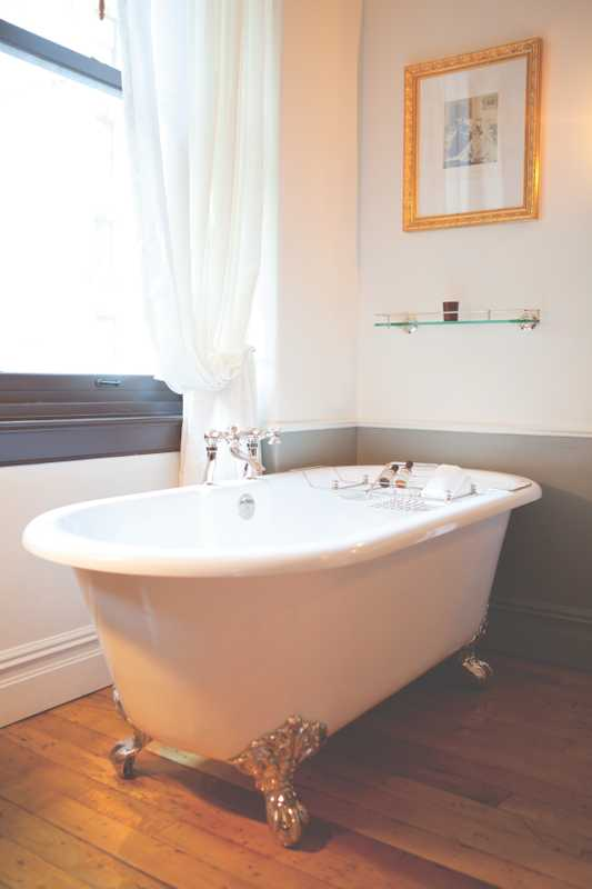 Freestanding bath in one of the bedrooms