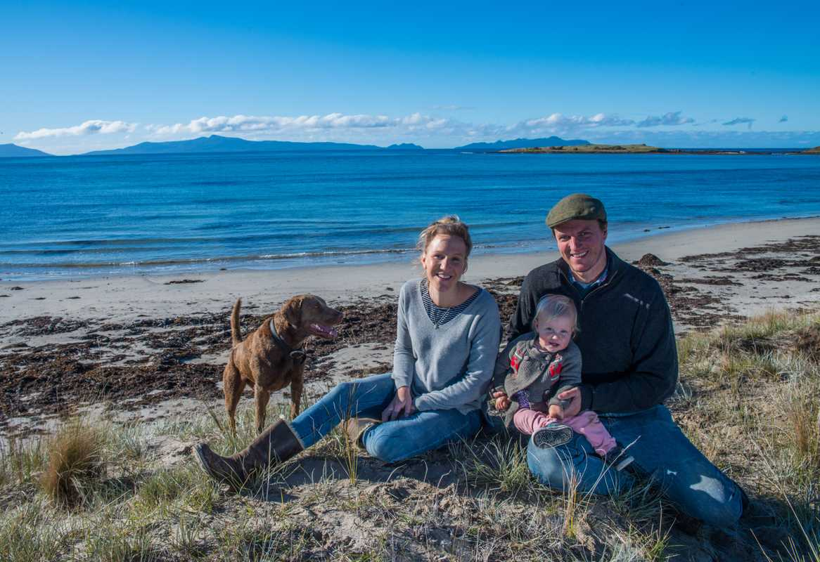 Producers Alice Laing and Chris Manson with daughter Flora and dog Beauly in Great Oyster Bay in Tasmania