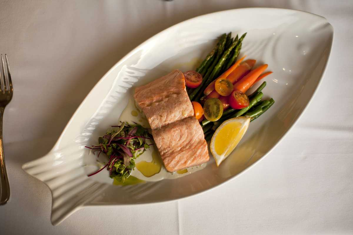 Poached salmon with market vegetables