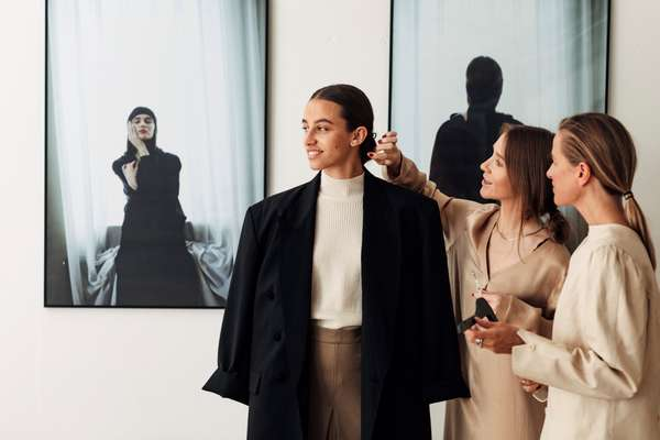 Pia Nordskaug (centre) and Celine Aagaard dressing a model