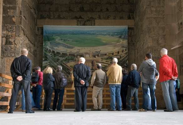 Tourists admire a photo of the airport inside Tempelhof's hall