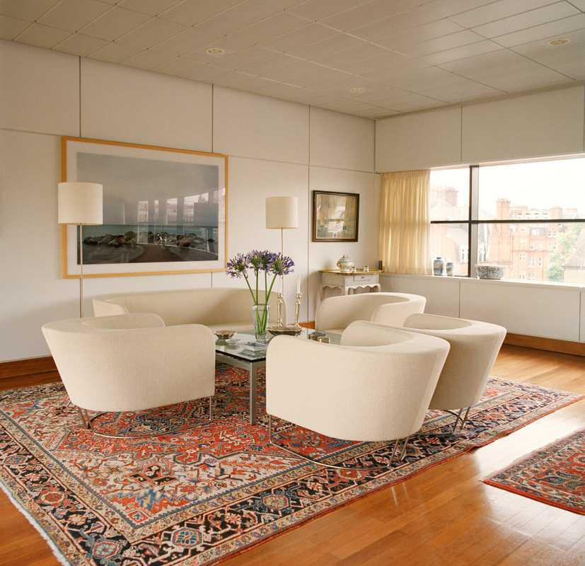Oriental rugs cover the polished wooden floors