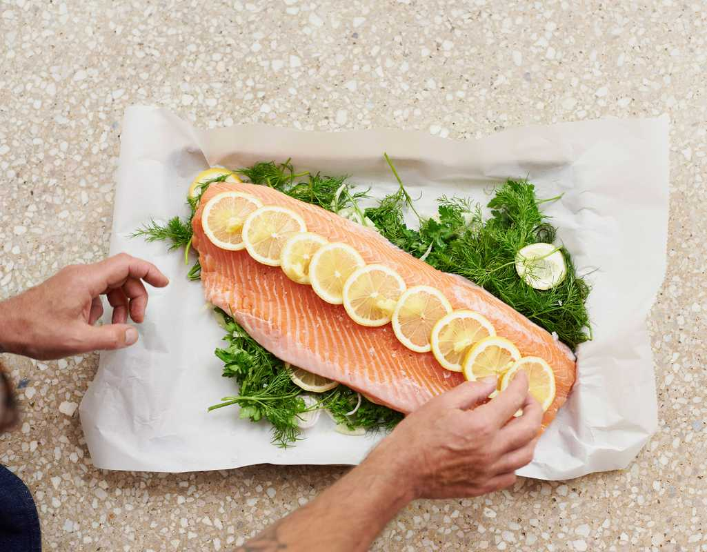 Salmon on a bed of herbs