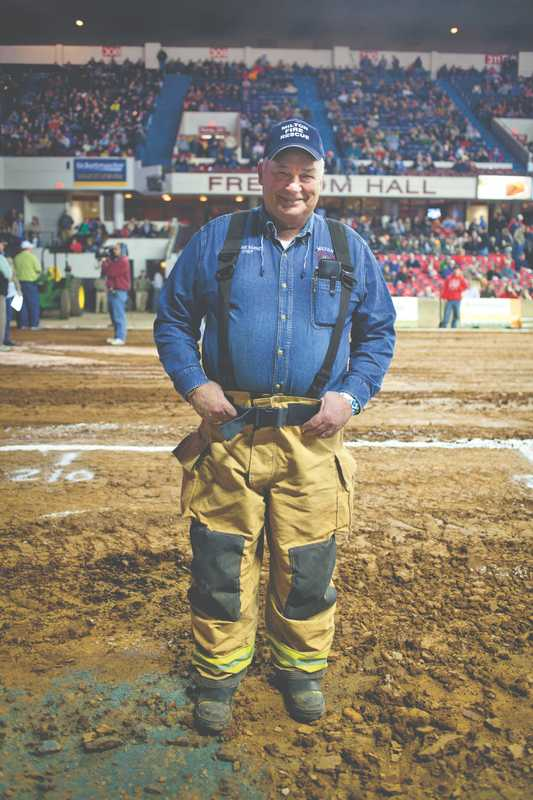 A fireman on hand at the tractor pull event