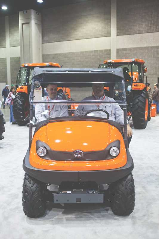 Kubota salesmen relax in one of the new RTVs