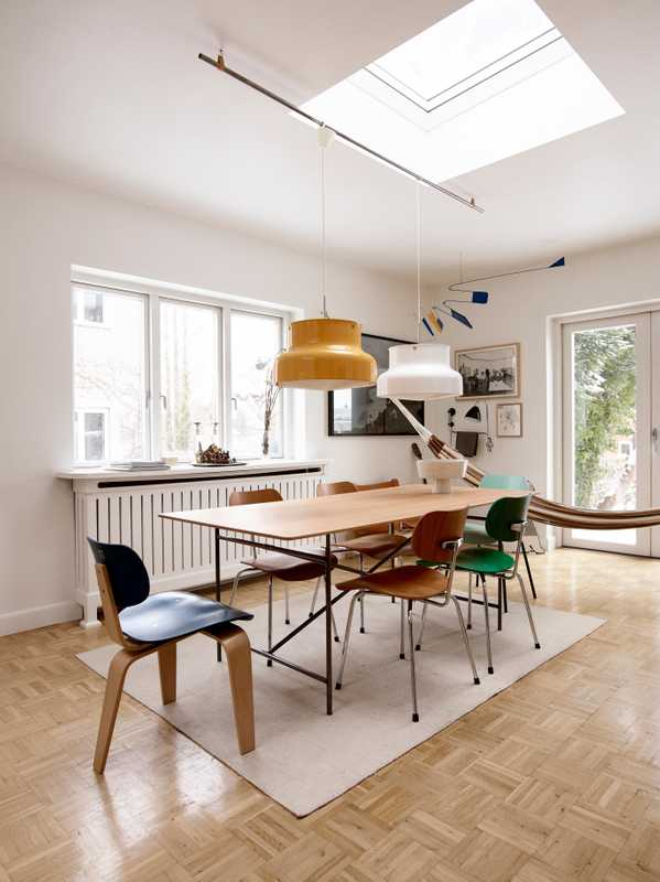 "*Table and chairs:* by Ibsen's brand, Please Wait To Be Seated. ""The table frame and chairs are a 1950s design by [German Functionalist architect] Egon Eiermann. I made the Oregon pine top myself."""