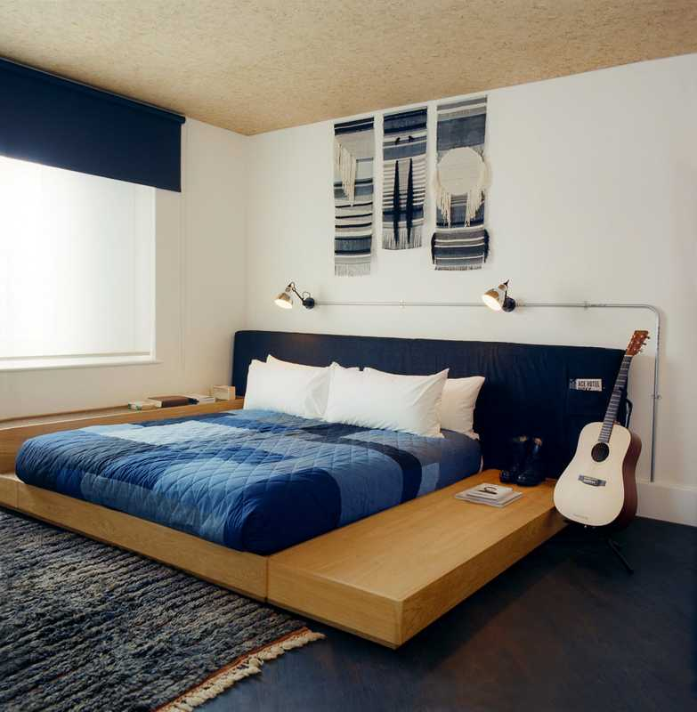 Bedroom in the suite; late-night guitar strumming is optional
