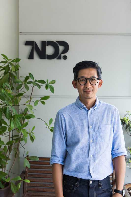 Tnop outside Tnop Design's office  in Bangkok's Bangkhen district